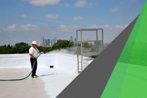 Leaking roof replacement by DFW urethane — man spraying SPF on a roof