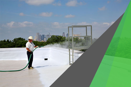 Leaking roof replacement by DFW Urethane —man spraying SPF on a roof