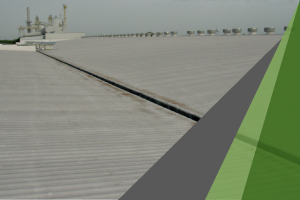 The roof of a large commercial building is covered in spray foam, which also provides excellent insulation for metal buildings.