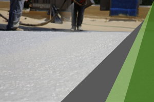 White spray foam that has been applied to a flat commercial roof. SPF is well known to survive disaster conditions.